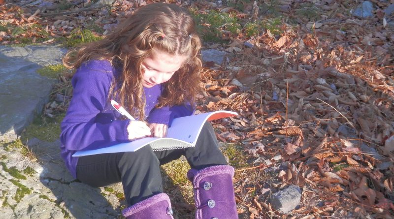 Homeschool child writing outside