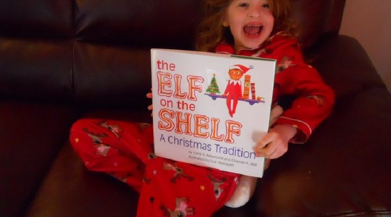 The Elf on the Shelf girl and book