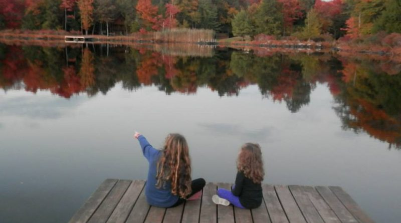 Kids sitting in dock in autumn